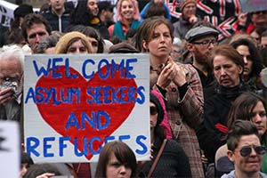 Crowd welcoming asylum seekers.